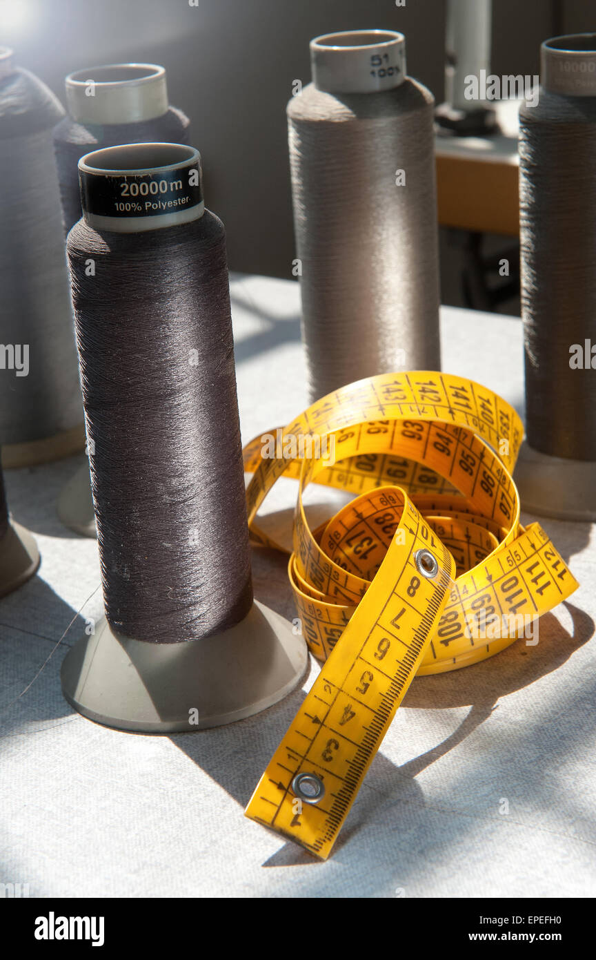 Tape measure and spools of yarn - Stock Image