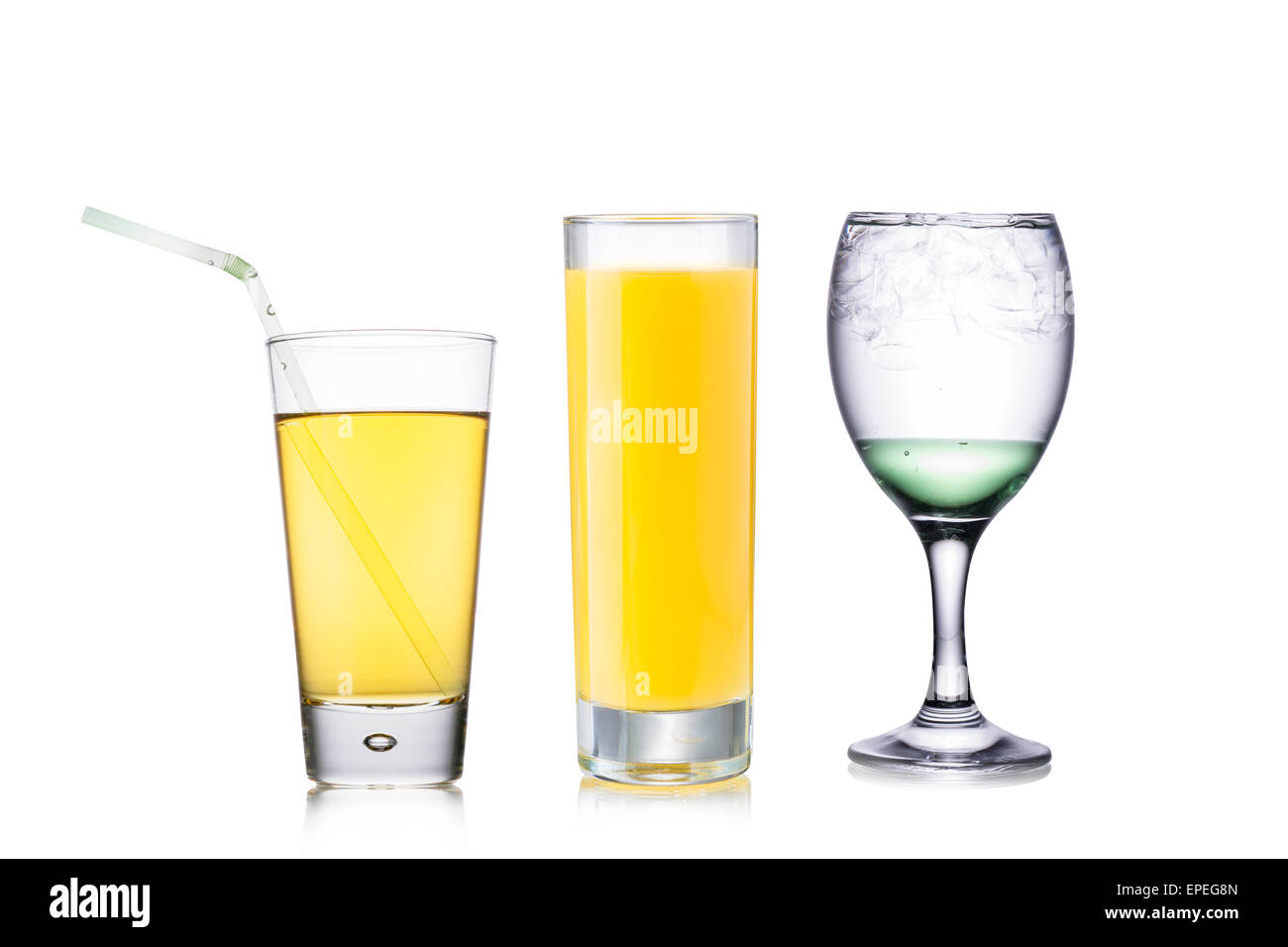 Set of beautiful backlit glasses filled with colored opaque and transparent liquids - Stock Image
