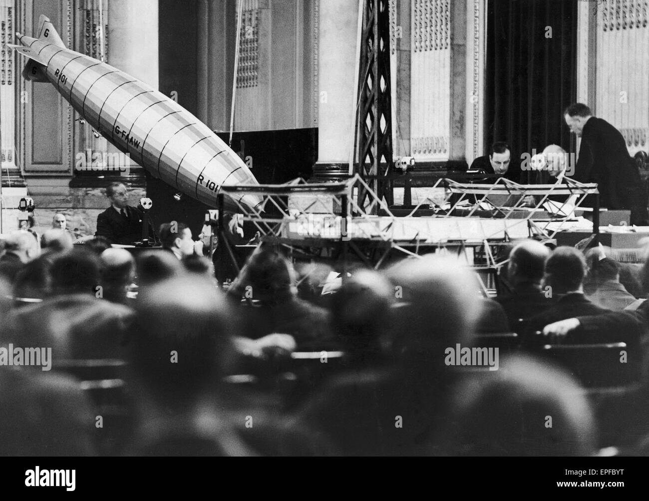 A model of the R101 at a 45 degree angle as engineer J Harry Leech is seen here giving evidence at the court of - Stock Image