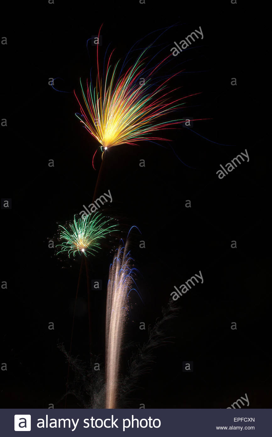 Fireworks exploding in the night sky. - Stock Image