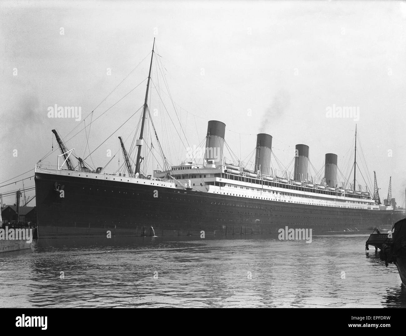 White Star Line liner RMS Olympic, sistership of the ill fated Titanic seen here in Southampton docks for her yearly - Stock Image