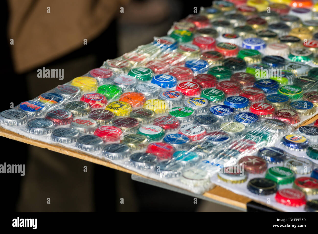 Bottle caps for sale at street market in Madrid - Stock Image