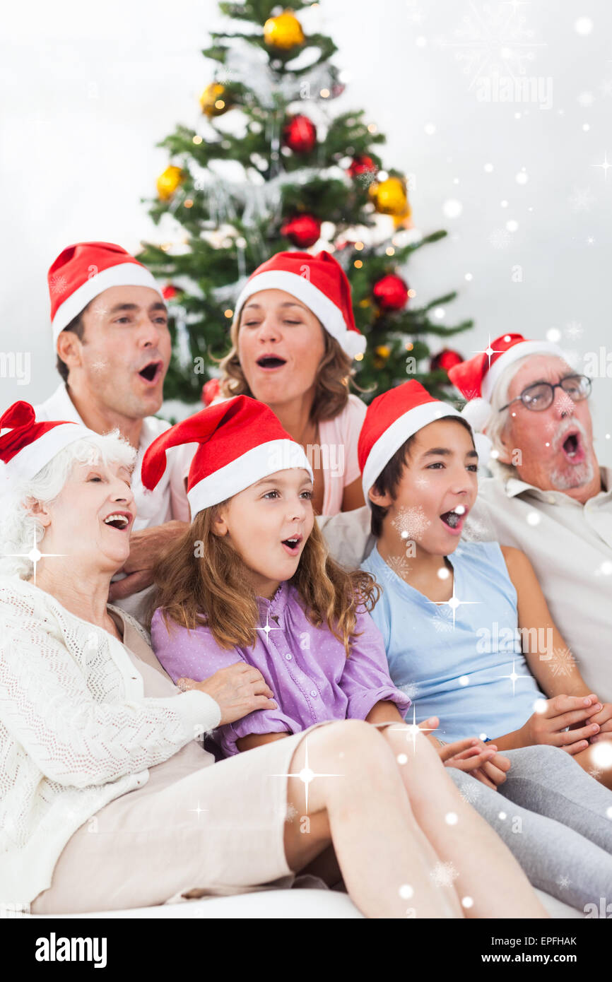 Extended family singing christmas carols - Stock Image