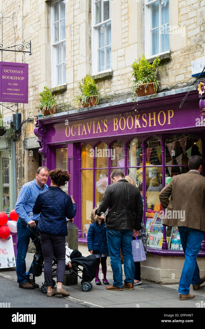 People standing and chatting in the street outside Octavia's Bookshop, a small independent book seller shop, - Stock Image