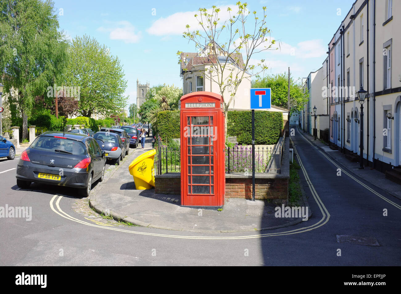 A British red public telephone box in the centre of a street in Bristol. - Stock Image