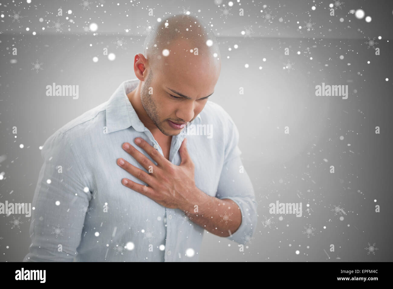 Composite image of casual young man with chest pain - Stock Image