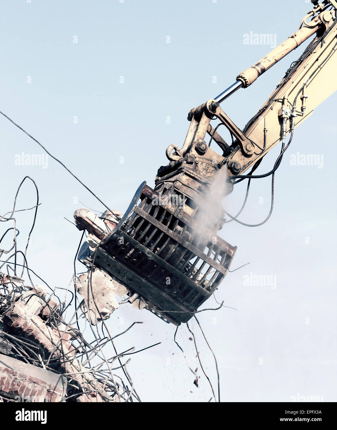 Demolition crane dismantling a building - Stock Image