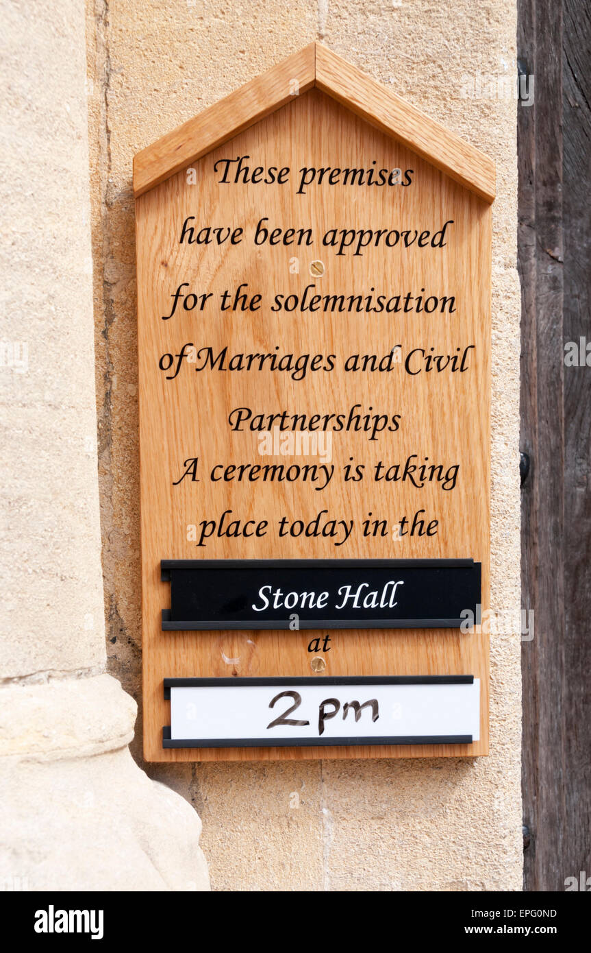 Sign announcing marriage or civil partnership ceremony in the Stone Hall of King's Lynn Town Hall. - Stock Image