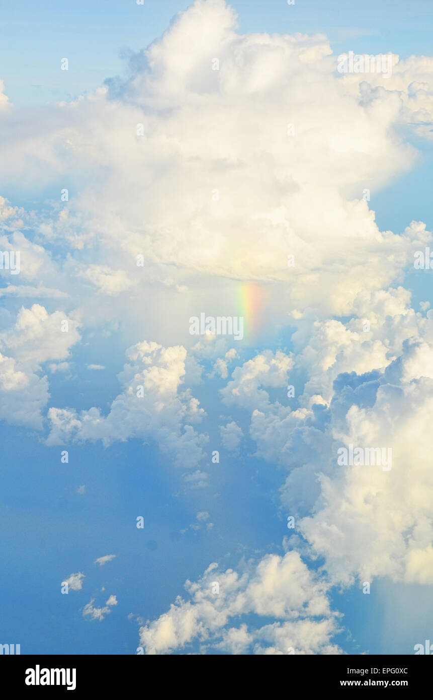Rainbow spotted under the cumulonimbus (rain clouds) above the Sea of Java - Stock Image