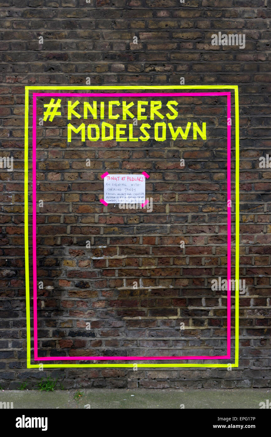 Knickers Model's Own sign on wall in Notting Hill.  DETAILS IN DESCRIPTION. - Stock Image