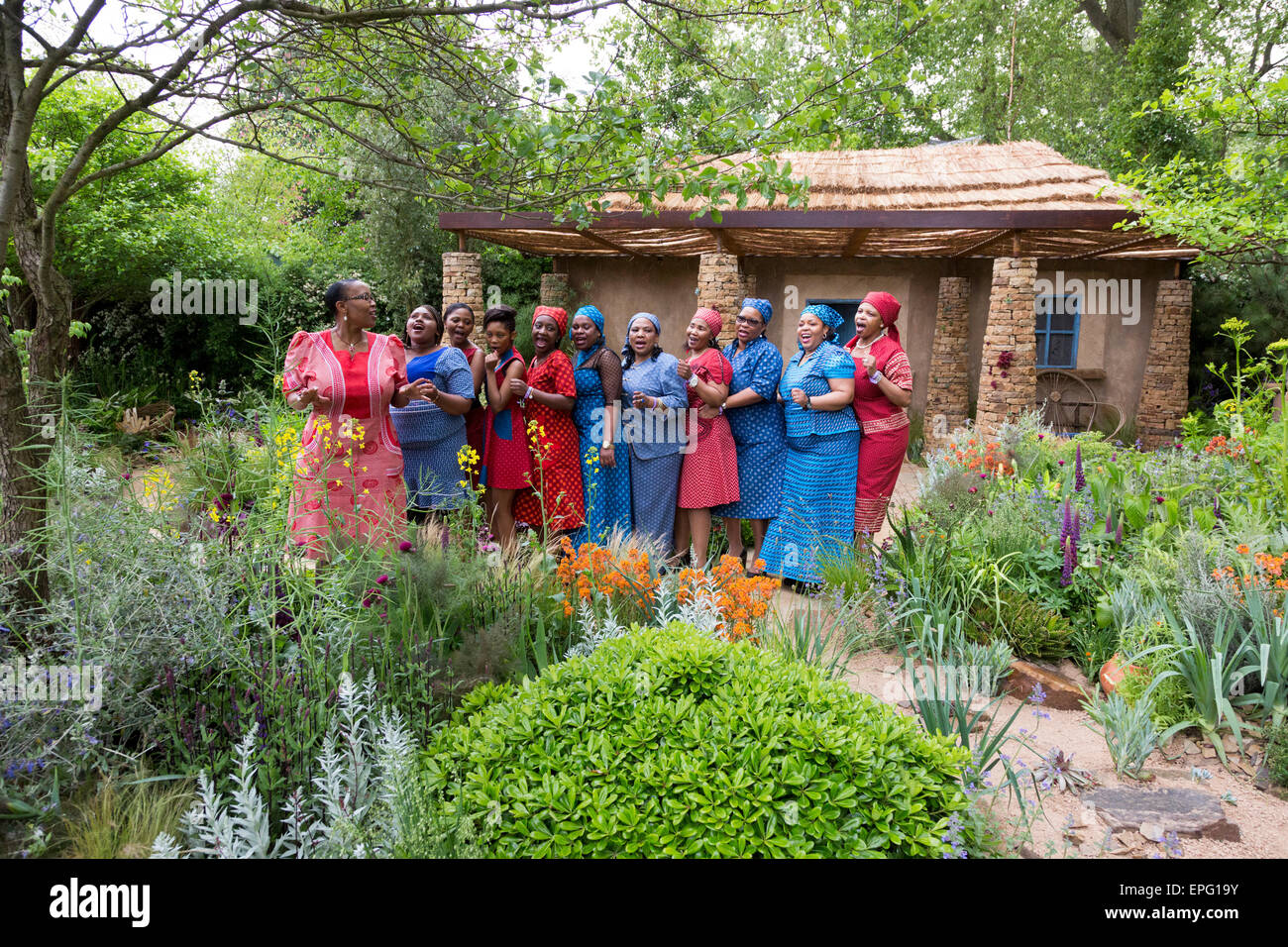 London, UK. 18 May 2015. A cheerful performance despite the bad weather from the Basotho Diaspora Choir at the Sentebale - Stock Image