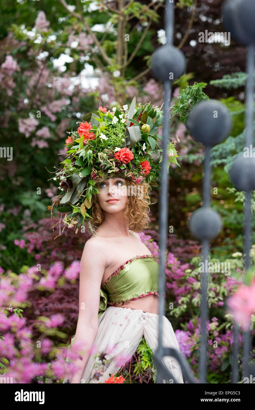 London, UK. 18 May 2015. Model Raine wears a dress and headdress made of flowers and foliage made by stylists Okishima Stock Photo