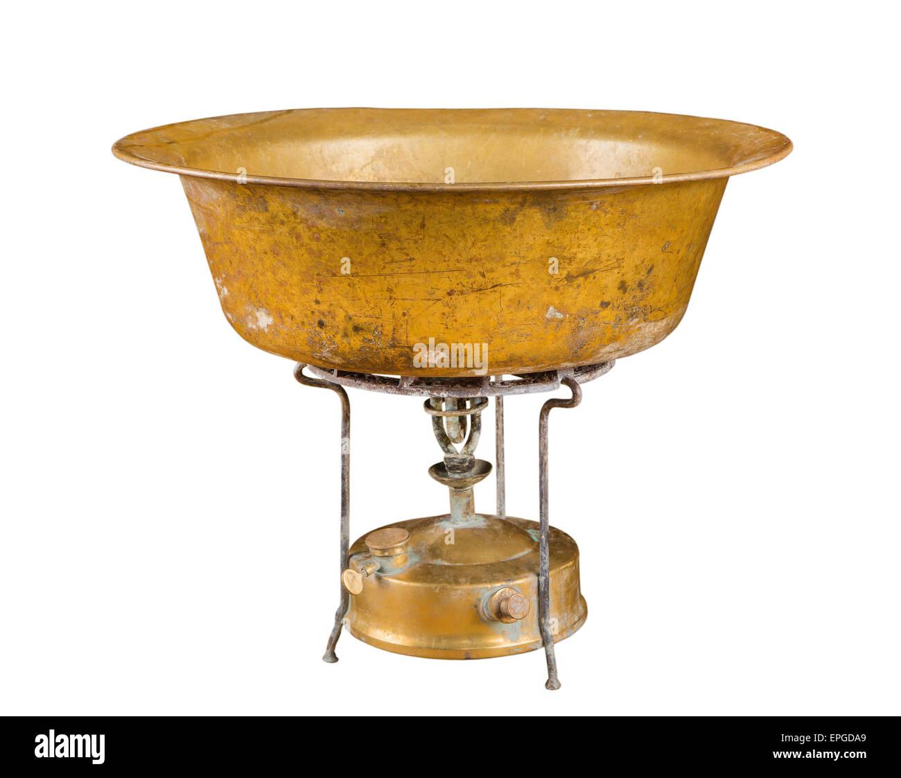kerosene stove and copper basin - Stock Image
