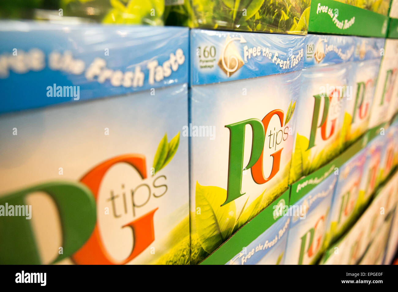 Boxes of PG Tips tea bags in a supermarket - Stock Image
