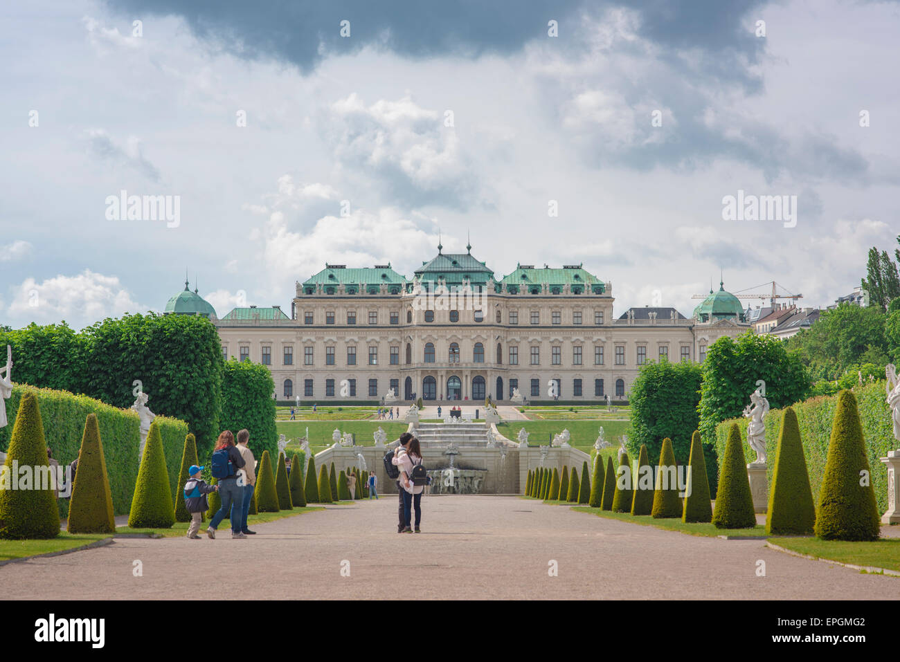Vienna Belvedere Palace garden, tourists at the Schloss Belvedere take a morning stroll through its famous landscaped - Stock Image