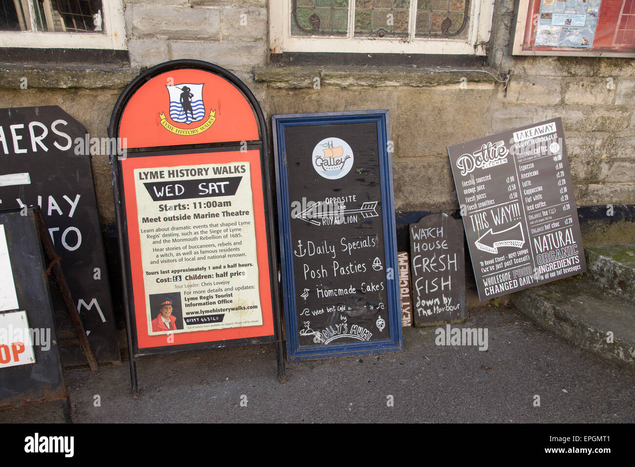 What's on, what to do in Lyme Regis, boards advertising things to do - Stock Image