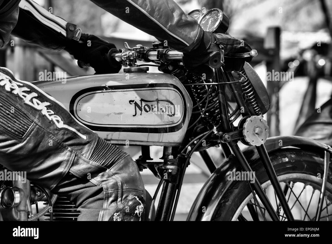 Biker on a vintage norton motorcycle. Black and white - Stock Image