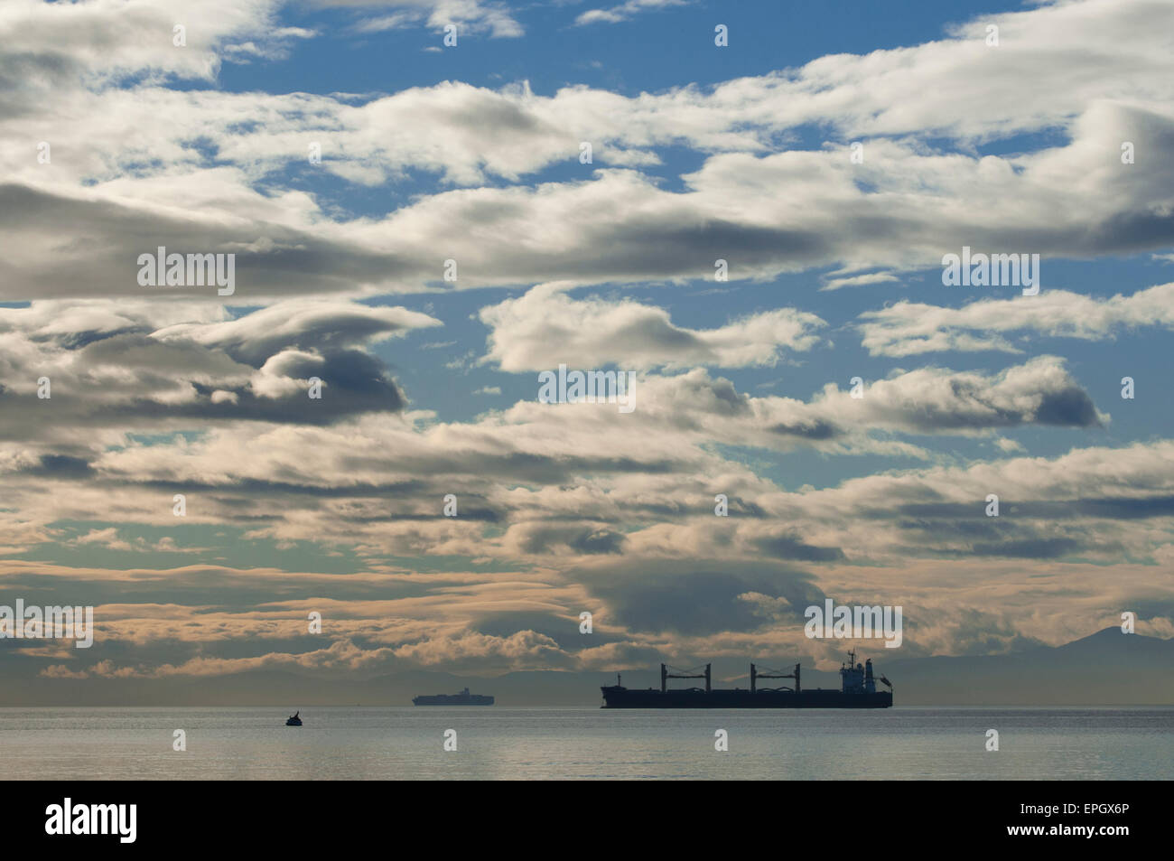 Freighters anchored off of Victoria BC, Canada, in Straits of Juan de Fuca, Salish Sea - Stock Image