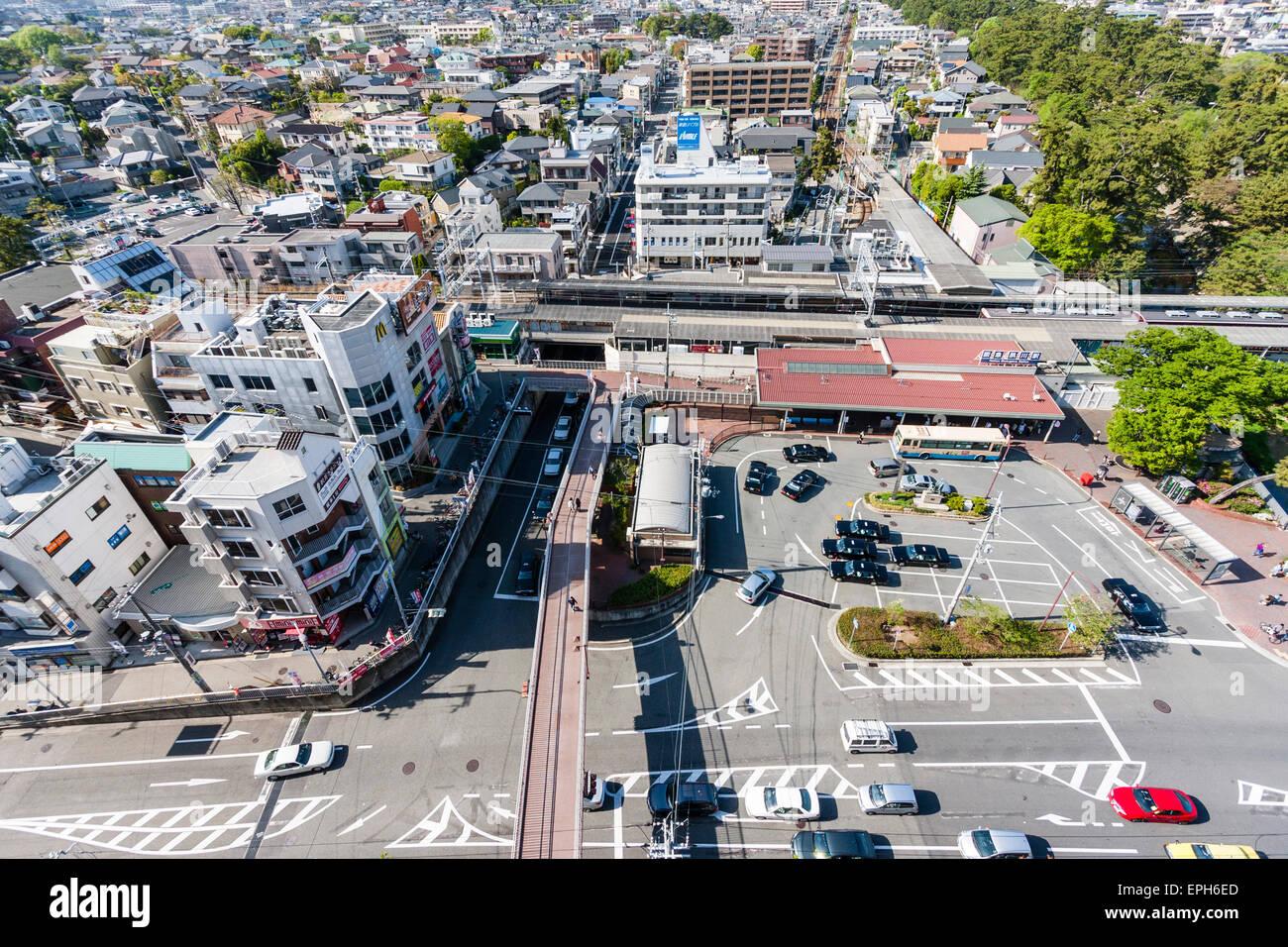 Japan, Nishinomiya, Shukugawa. Ariel view of town, mainly the Hankyu train station. - Stock Image