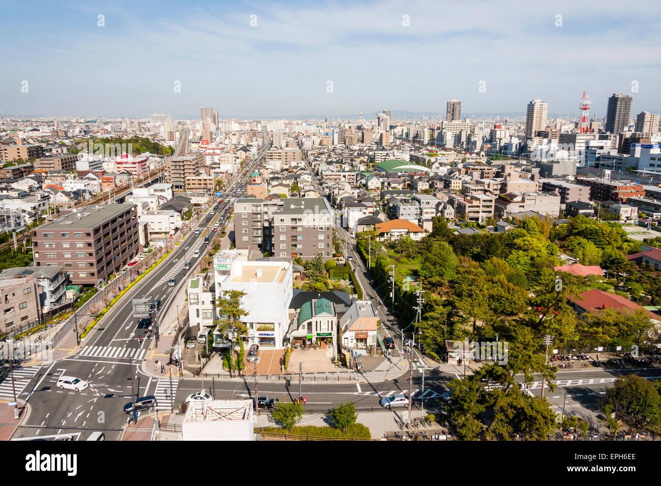 Japan, Nishinomiya, Shukugawa. Ariel view of town, towards Osaka, showing Hankyu and JR railway lines and main street. - Stock Image