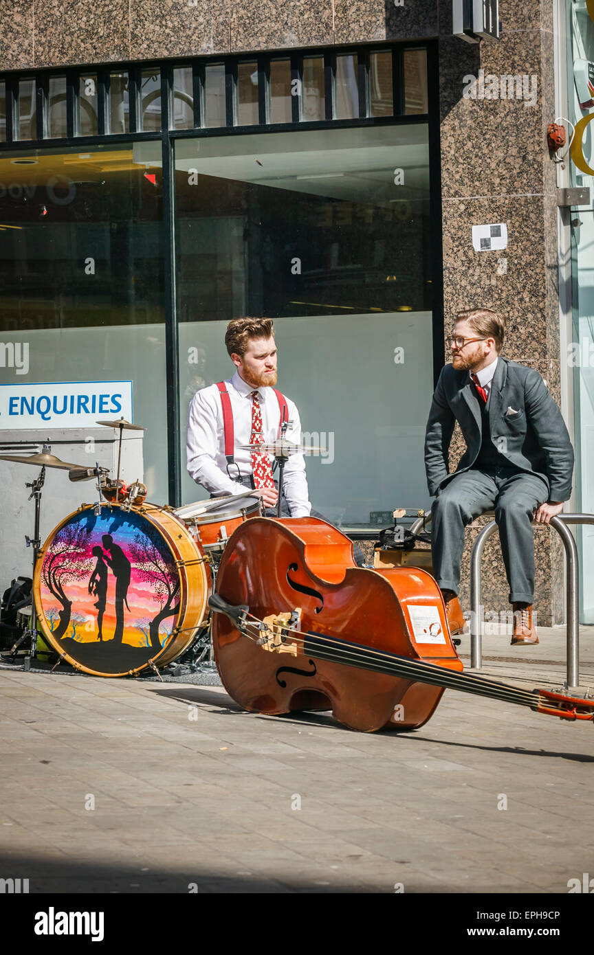 Briggate Busy Shopping District, Leeds West Yorkshire,Two Young Street Musicians Taking a Break, - Stock Image