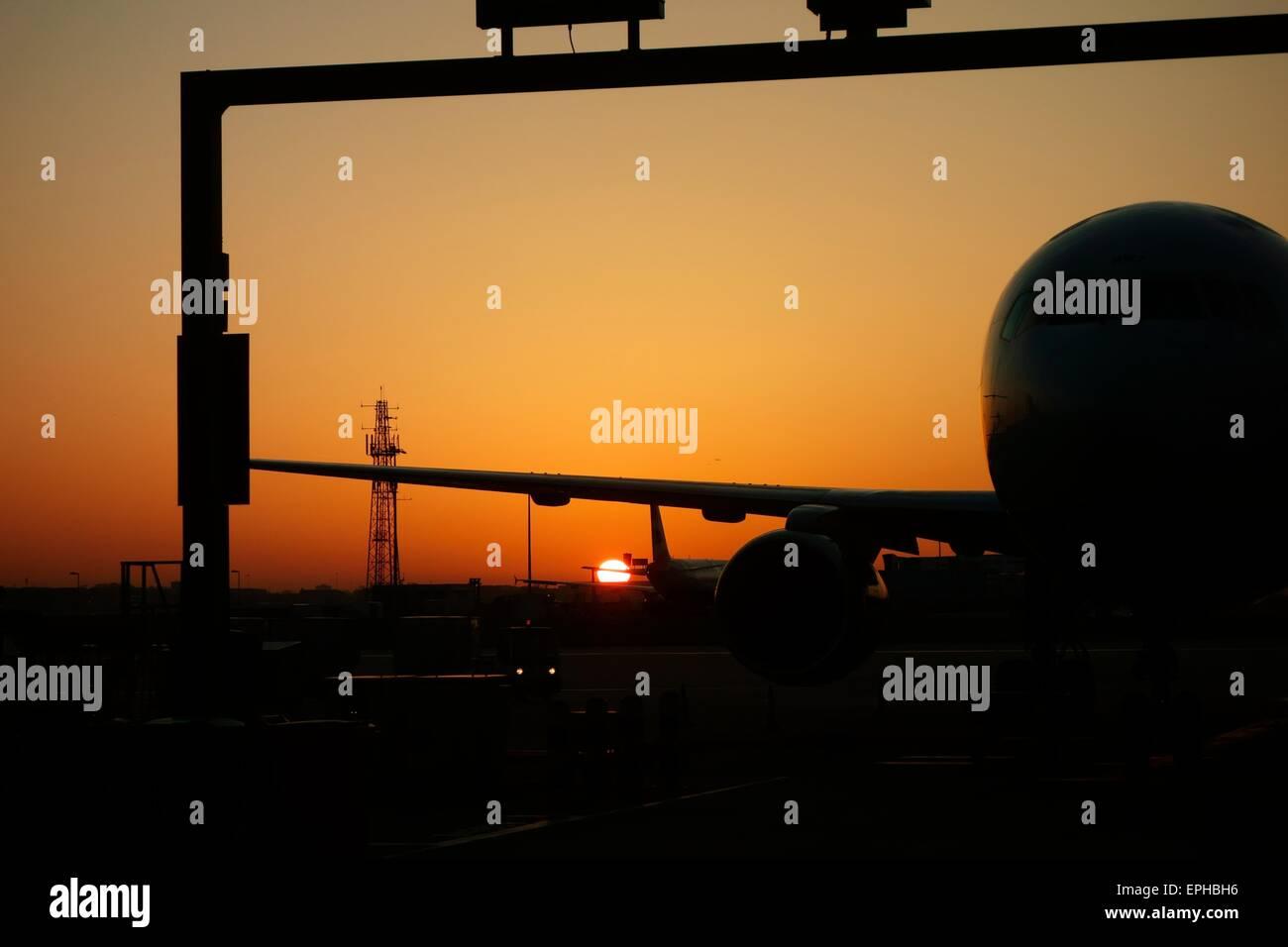 Sunrise over Heathrow Airport - Stock Image