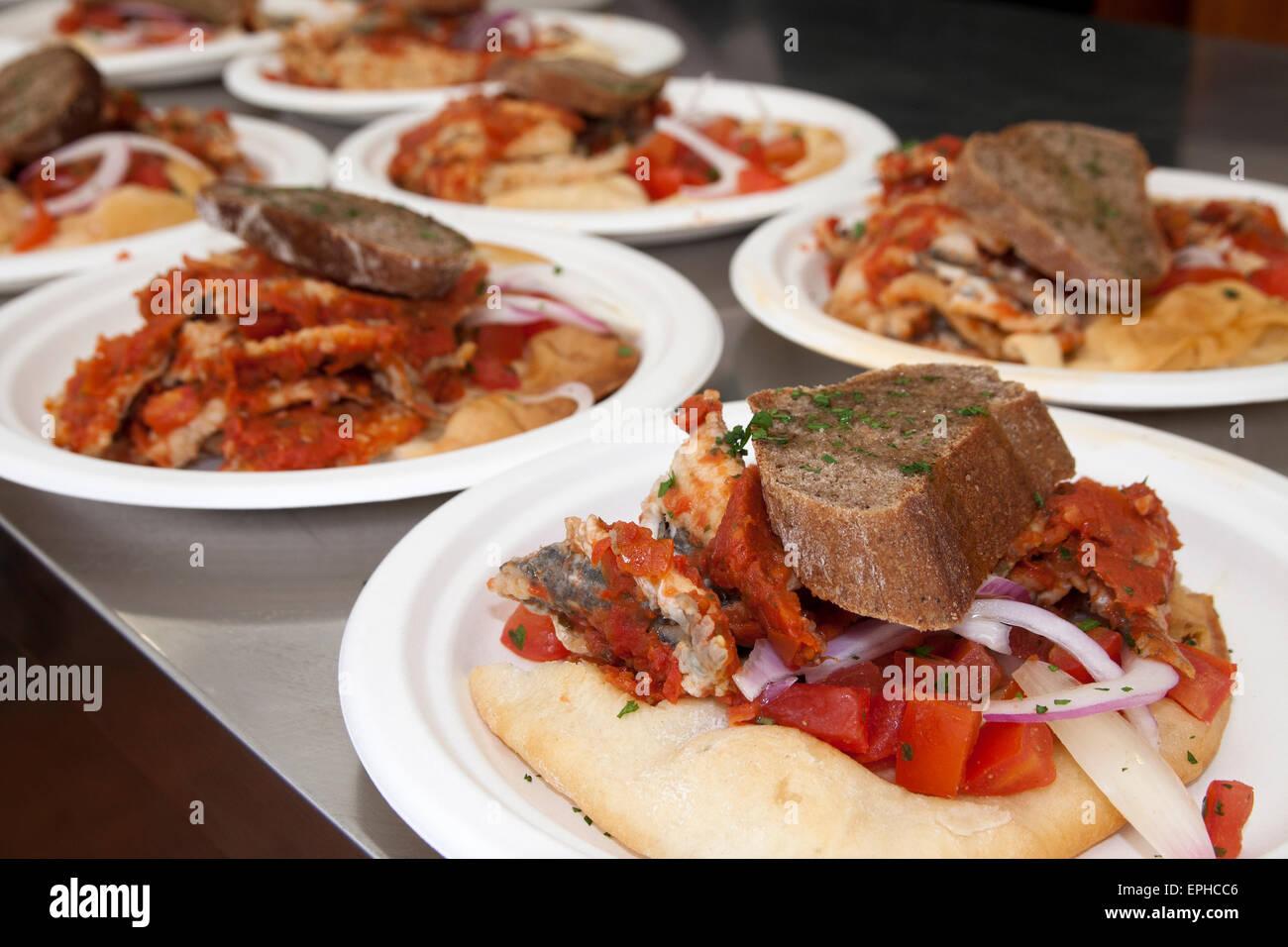 anchovies with bread, onions and tomato, bagnun di acciughe con galletta del marinaio, italian seafood - Stock Image