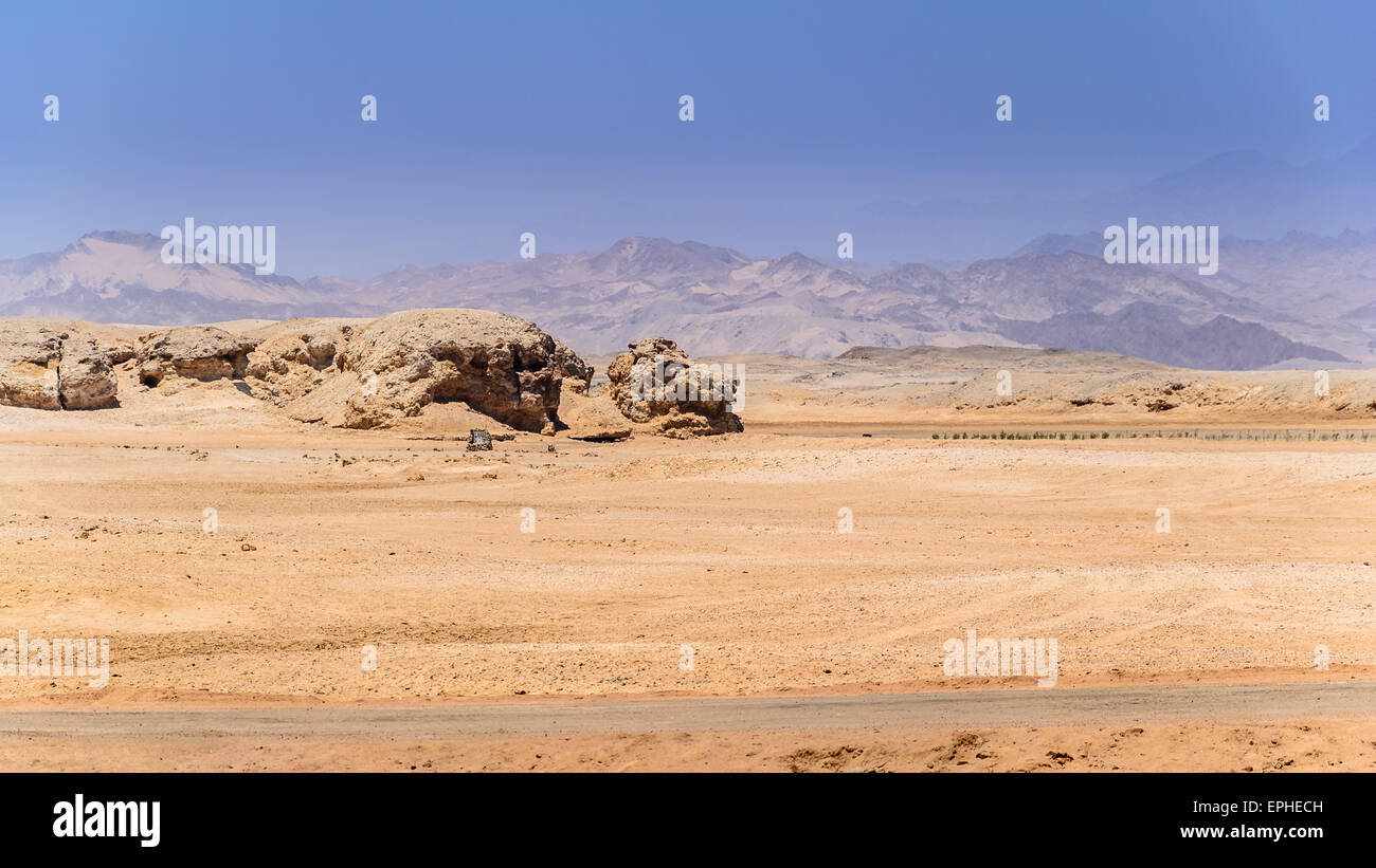 In the picture the rocky desert that surrounds the national park of Ras Mohammed in Egypt , and in the background - Stock Image