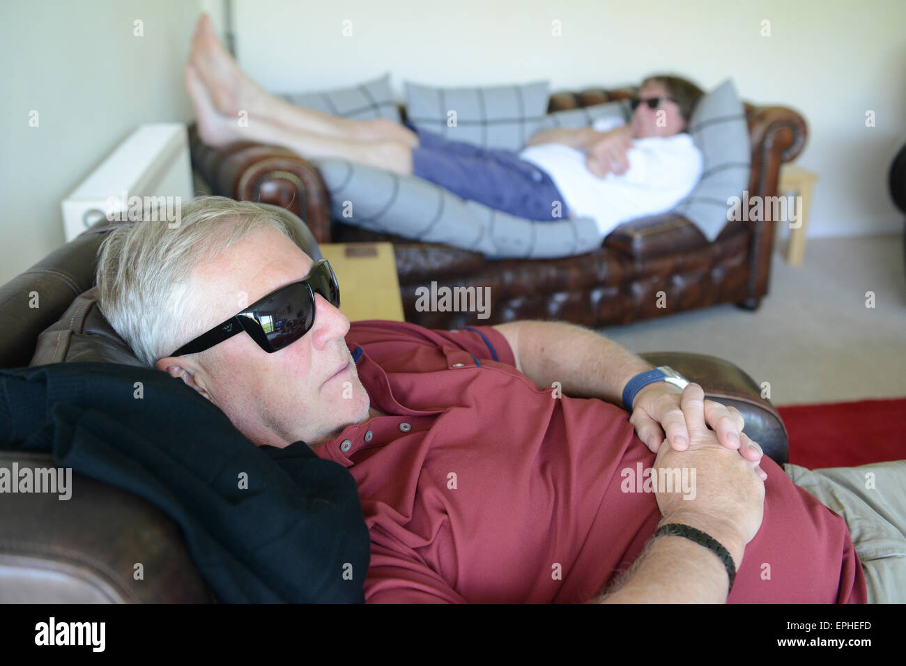 Men man afternoon nap sleep sleeping daytime relaxing relaxed - Stock Image