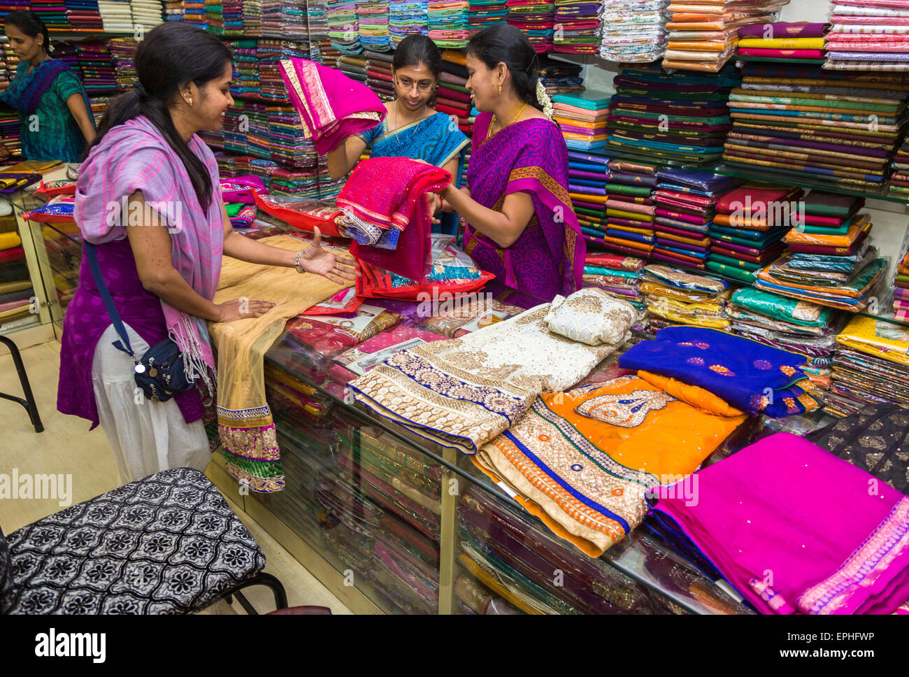 cc49dd566d Clothes and fabrics shop with brightly coloured materials for saris and  local costumes, Chennai,