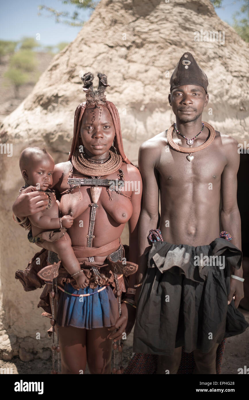Himba tribe village couple and child posing