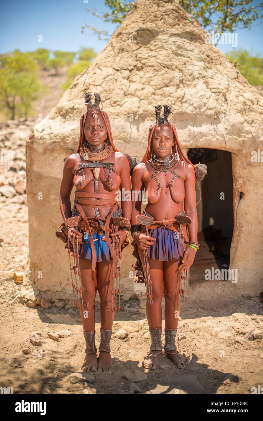 Africa, Namibia. Himba Tribe Village. Full body image of two native woman. - Stock Image