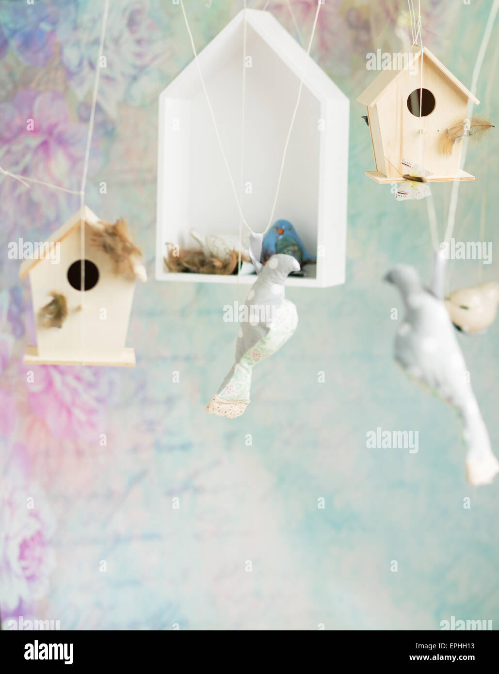 Vintage background with wooden toy birds - Stock Image