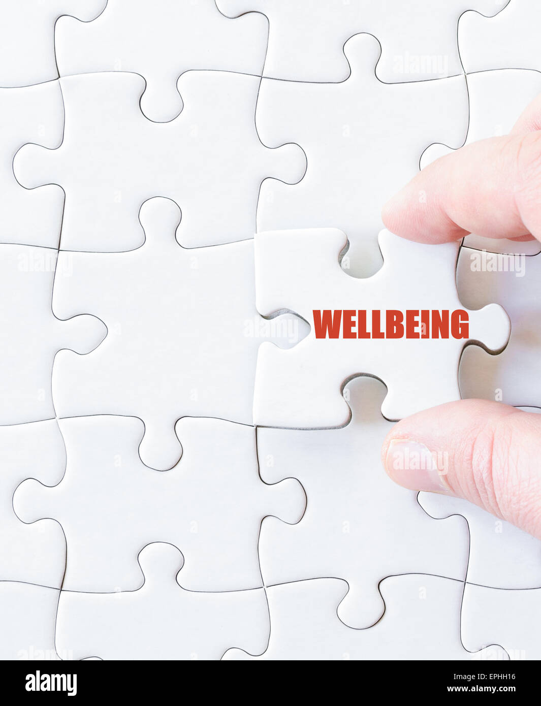 Missing jigsaw puzzle piece with word  WELLBEING. Concept image for completing the puzzle. - Stock Image