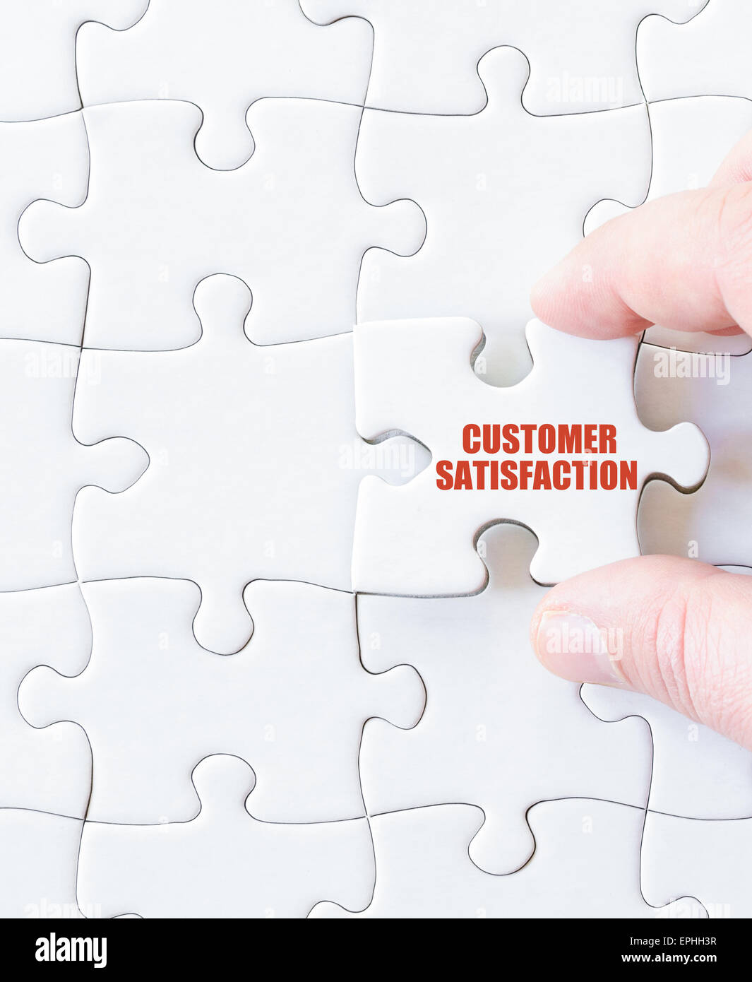 Missing jigsaw puzzle piece with words  Customer Satisfaction. Business concept image for completing the puzzle. - Stock Image
