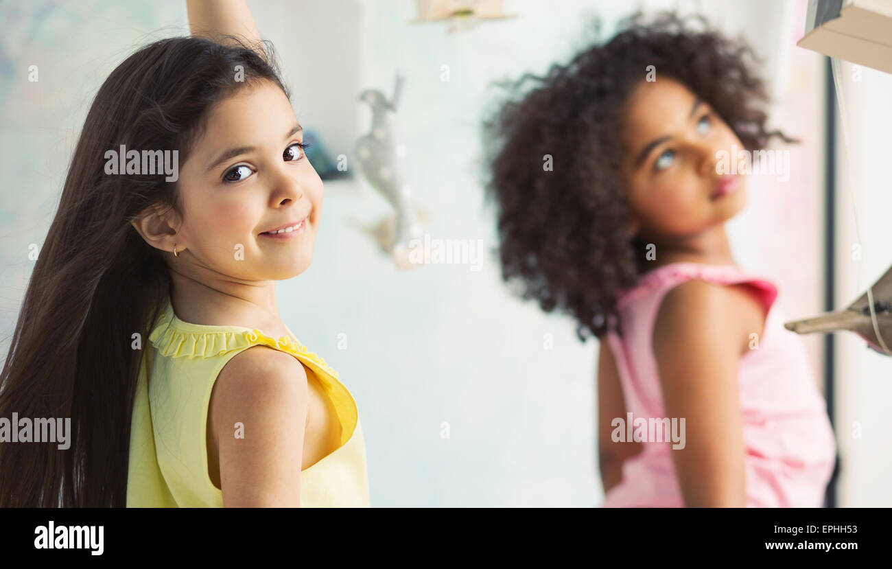 Two little adorable girls playing together - Stock Image