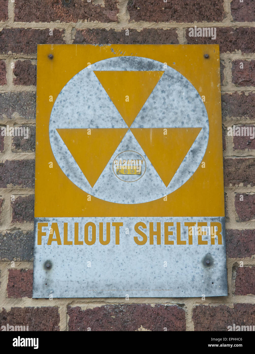 Faded fallout shelter sign. Stock Photo