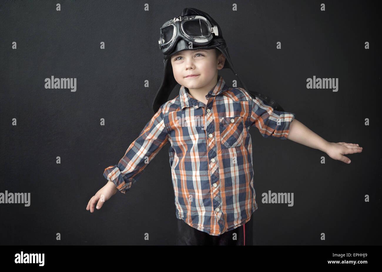 Portrait of a little cute pilot - Stock Image