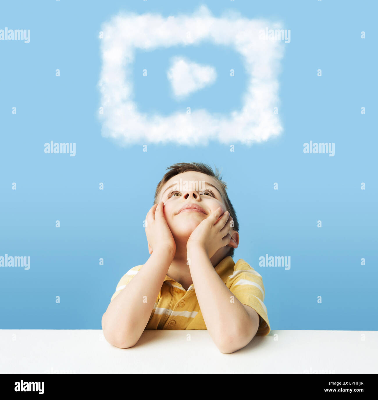 Little man dreaming about cloudlet shapes - Stock Image