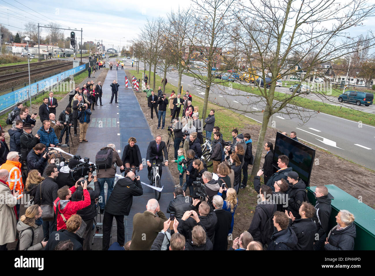 Dutch minister Henk Kamp opens Solaroad world's first solar bicycle cycle lane in Krommenie Netherlands 2014. - Stock Image