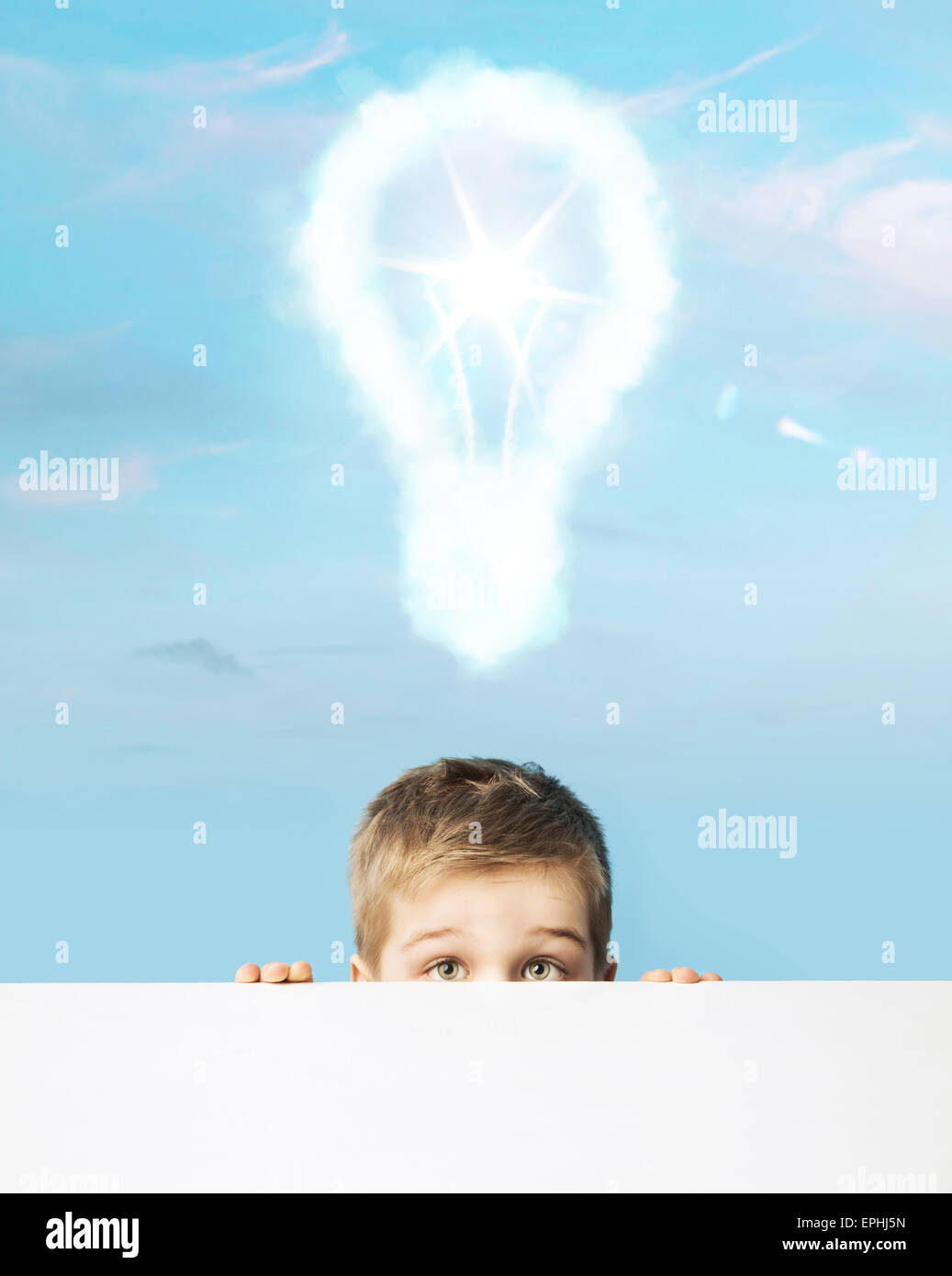 Little boy with a light bulb above head - Stock Image