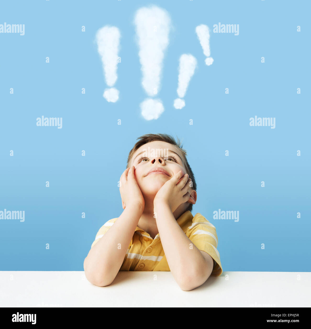 Little boy with exclamation marks above head - Stock Image