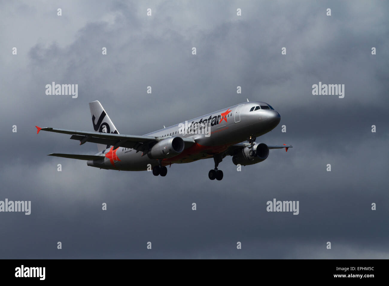 Jetstar Airbus A320 landing at Auckland International Airport, Auckland, North Island, New Zealand - Stock Image