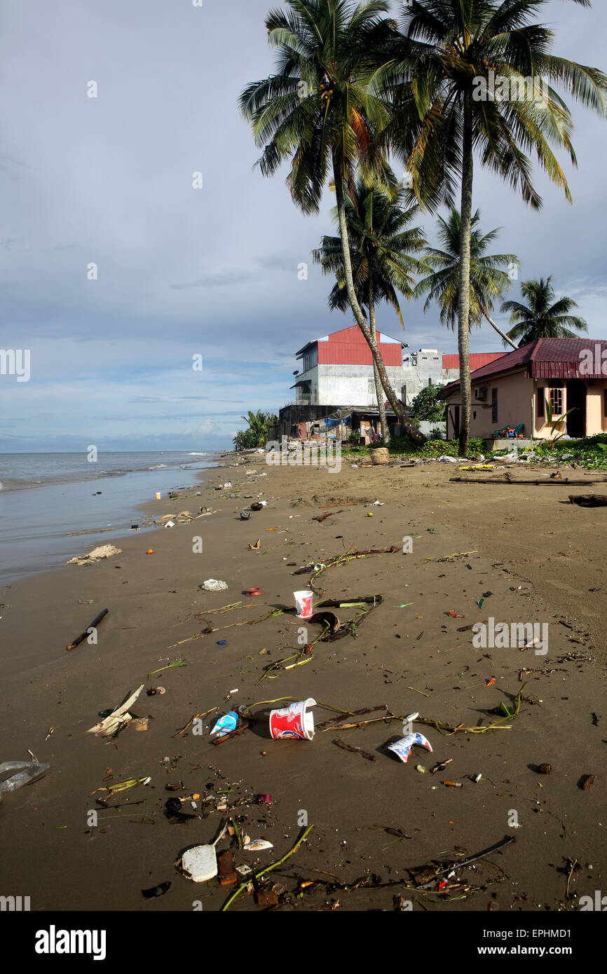 Plastic trash and other garbage on urban beach in Sumatra, Indonesia - Stock Image