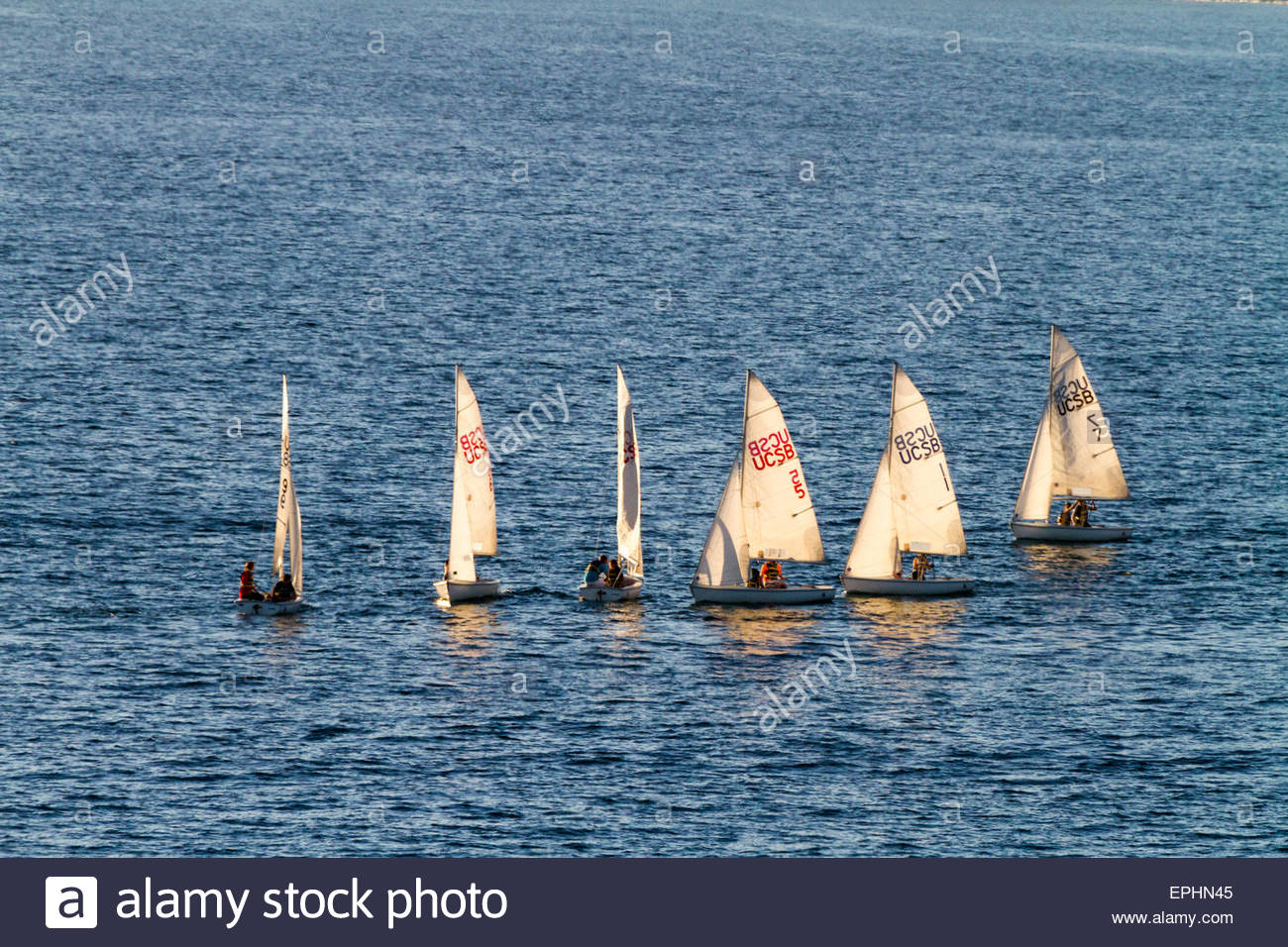 Sailboats compete on the Pacific Ocean off the coast of Santa Barbara, California - Stock Image