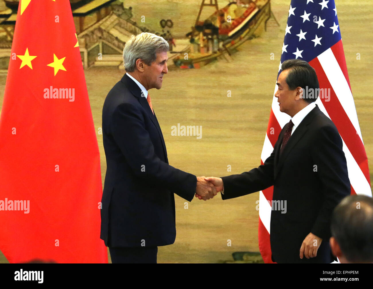Beijing, CHINA, China. 16th May, 2015. U.S. Secretary of State John Kerry (L) shakes hands with Chinese Foreign - Stock Image