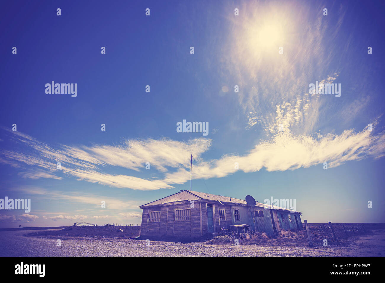 Vintage instagram effect toned picture of abandoned house on desert of Patagonia. - Stock Image