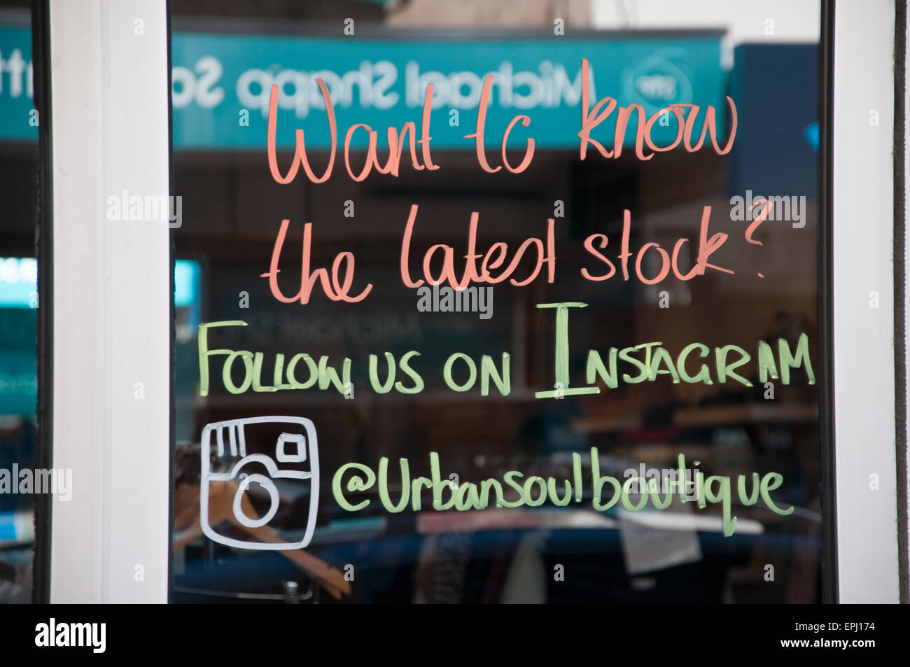 Social media marketing message on the door of a boutique in Glen Huntly Road, Elsternwick, Melbourne - Stock Image
