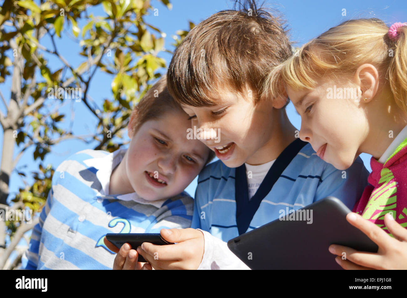 kids with smartphone - Stock Image