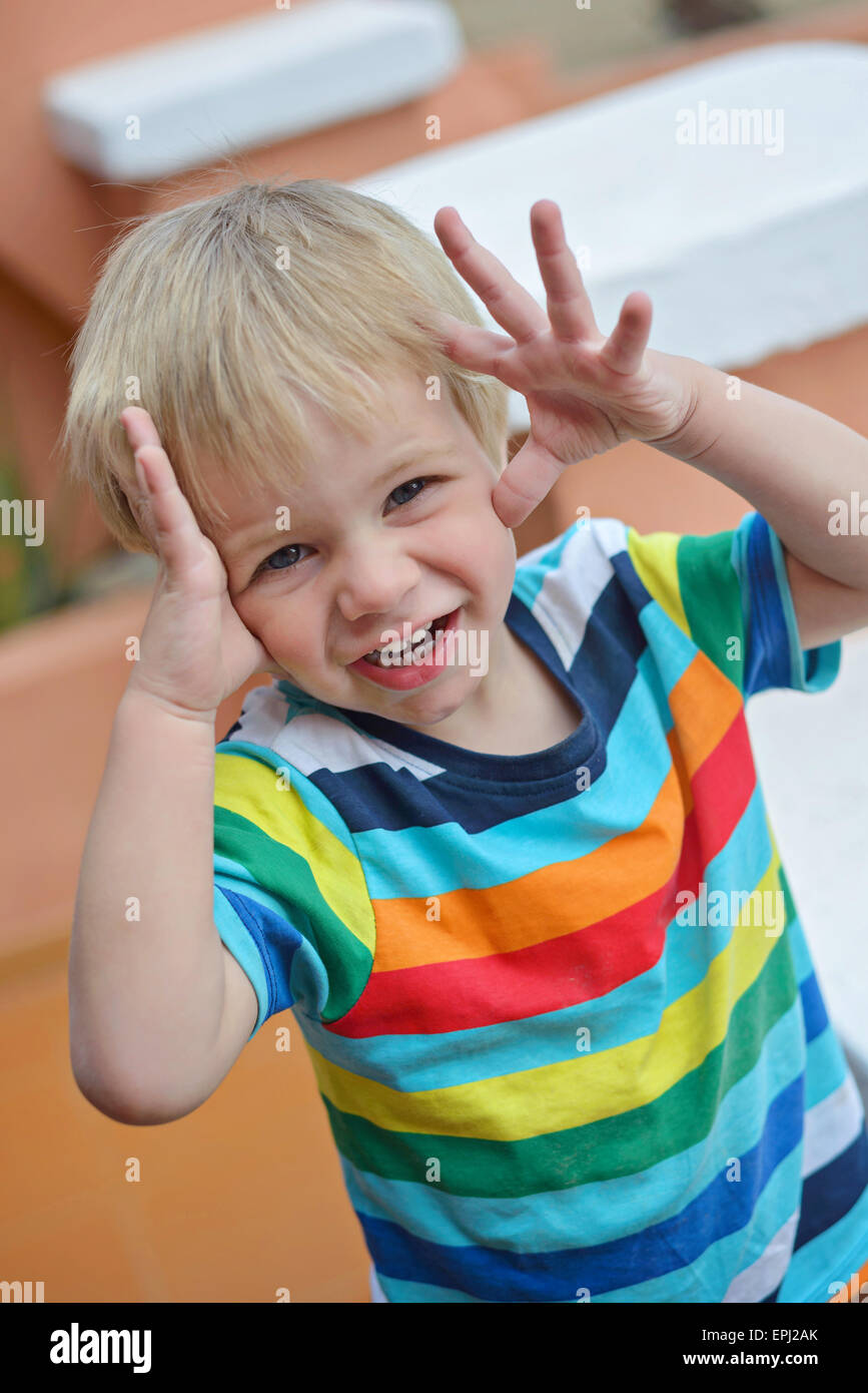 Little boy playing hide-and-seek - Stock Image